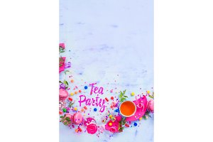 Tea party concept with paper text, candies, sweets, confetti, macarons. Colorful Birthday celebration flat lay with copy space.