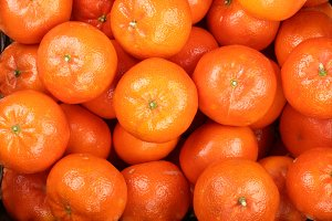 Mandarin, tangerines in the market as a background close-up