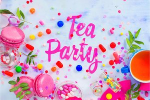 Tea party concept in pink tones with paper text, candies, sweets, confetti, macarons. Colorful Birthday celebration flat lay with copy space.