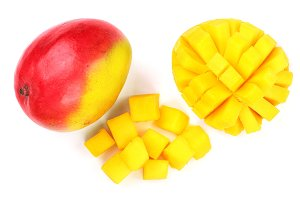 Mango fruit and half isolated on white background close-up. Top view. Flat lay