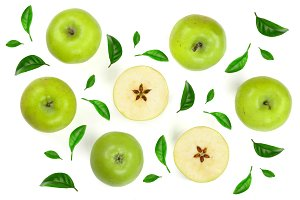 green apples with slices decorated with leaves isolated on white background top view. Flat lay pattern