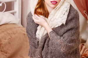 Girl in knitted scarf