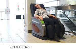 Woman relaxing in massage chair