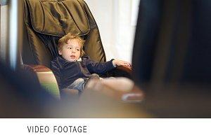 Little child sitting massage chair