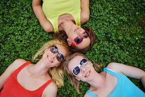 three girls having fun outdoors