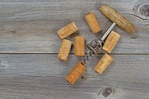 Several used Wine Corks on aged wood