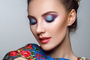 beautiful girl with bright makeup in russian shawl