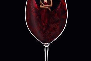 girl in red dress inside wine glass