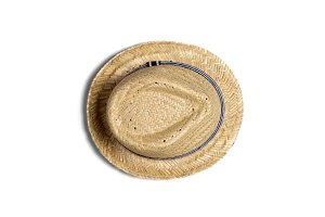 A mans brown straw hat isolated