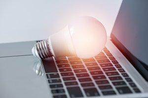 light bulb on laptop