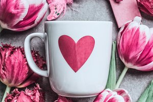 White mug with heart and pink tulips