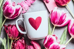 Mug with heart and fresh tulips