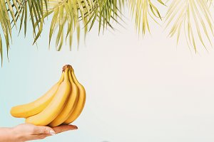 Summer Bananas in female hand