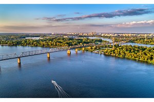 Aerial panorama of the Dnieper with the Petrovsky Railway Bridge in Kiev, Ukraine