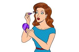 Girl paints eyelashes pop art vector