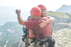 two man rock climbers climbed on the cliff