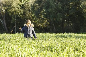 Child walking through the field