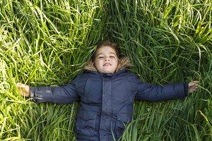 Boy lying on the long grass