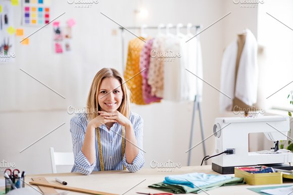 Young creative woman in a studio, startup business.