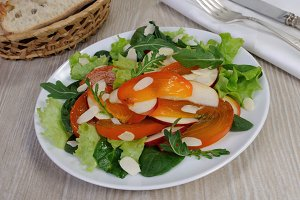 Salad greens with persimmon
