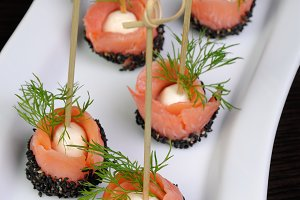Appetizer of salmon with mozzarella