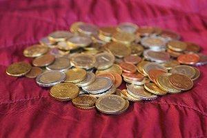 Euro coins, European Union over red velvet background