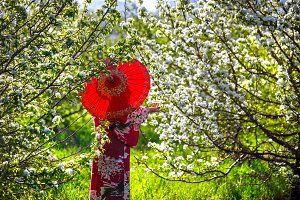 Woman in blossom garden