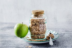 Wheat bran breakfast cereal in a glass jar for storage.  and a g