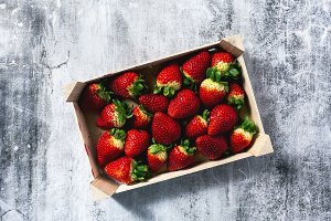 Pile of juicy ripe organic strawberries in a wooden box. sale on