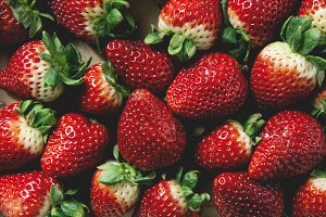 background of juicy ripe organic strawberries . close up, overhead shot