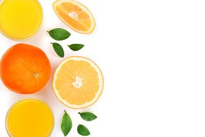 orange juice glass with slices of citrus and leaves isolated on white background with copy space for your text, top view