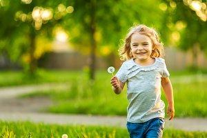 Little girl in spring sunny park