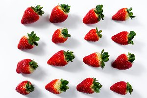 background of juicy ripe organic strawberries on white