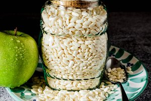 puffed rice in a glass jar for storage.  and a green appuffed ri