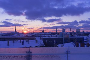 Sunset in winter over the city of Riga