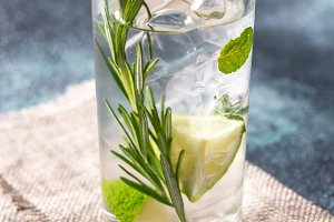 Glass of water with herbs