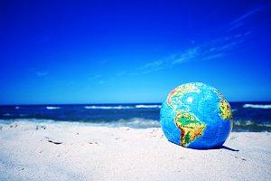 Earth globe on the beach