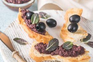 Toasts with black olive pate