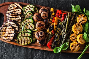 banner. a large portion of colored grilled vegetables and mushro