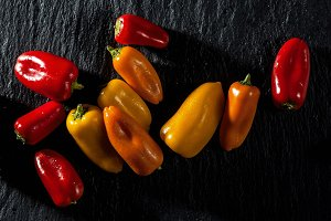 colored sweet pepper onbanner of colored sweet pepper on black s