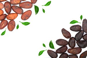 cocoa bean decorated with green leaves isolated on white background with copy space for your text. Top view. Flat lay