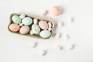 Painted eggs in paper tray.Flat lay