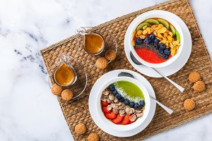 two bowls with different Smoothies from strawberries and kiwi, w