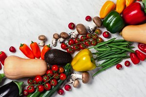 a variety of fresh Vegetables background on a white marble table