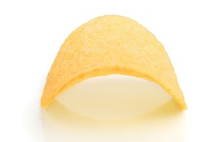 Single potato chip on white background close-up