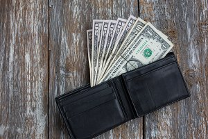 Money in the black leather wallet