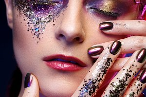 beautiful woman with bright makeup with glitter