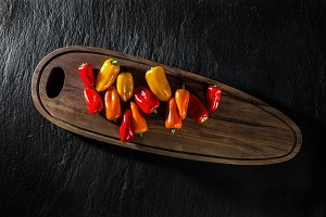 colored sweet pepper on black slate. background of food. organic