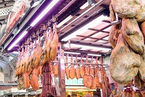 Valencia, Spain - December 30.2015: Row of jamon at market