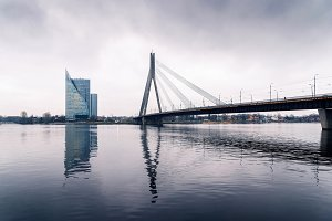 Winter in Riga, cloudy weather and view of the bridge over the r